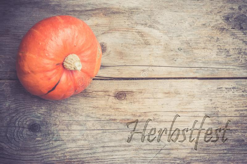 Autumn and harvesting: Pumpkin is lying on a rustic, wooden table.& x22;Herbstzeit. Orange pumpkin is lying on a rustic wooden table. & x22;Herbstzeit halloween stock photo