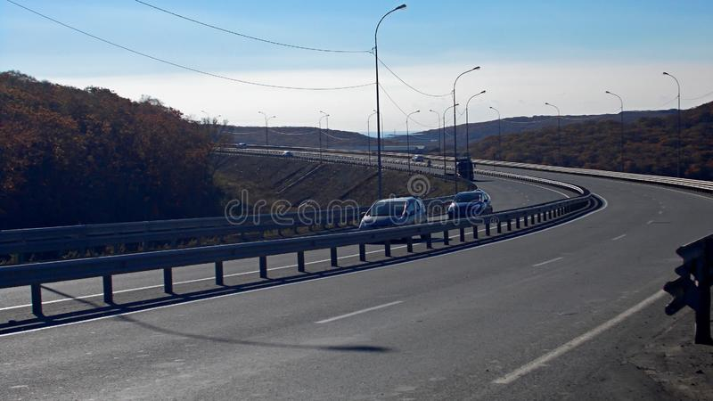 Autumn. Highway. Turn. Bright sunny day. stock images
