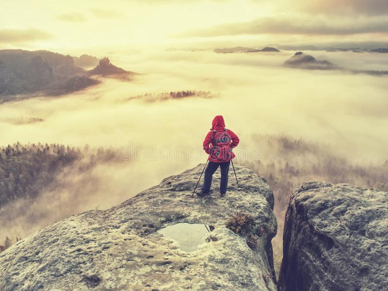 Autumn hike in foggy rocky mountains for hard adventurer. Alone woman hiker in rocks while extreme misty weather. Autumn hike in rocky mountains for hard stock photos