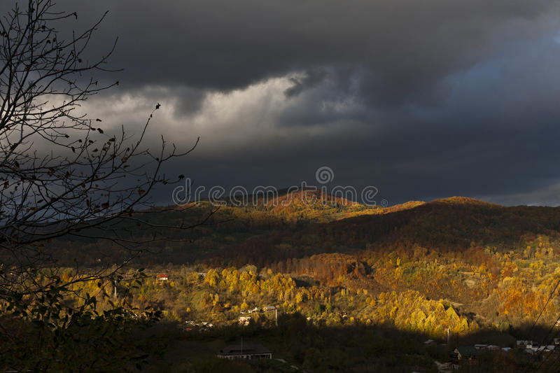 Autumn hill from Breaza, Romania. Cloud shadow over colorful autumn hill stock images