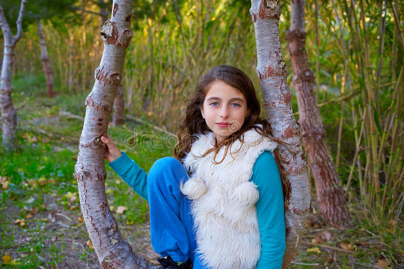 Autumn kid girl relaxed in forest with green canes stock image