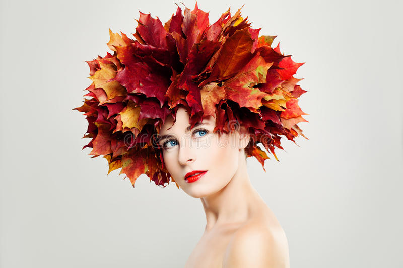 Autumn Lady. Perfect Woman with Healthy Skin. Cute Face, Makeup, Fall Leaves Wreath royalty free stock photo