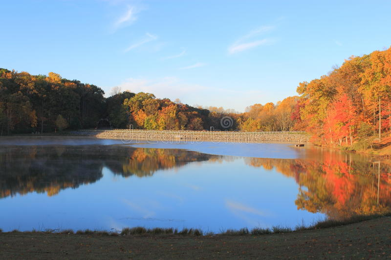 Autumn Lake. With colorful trees and blue sky at Great Seneca Creek Park, Maryland stock photo