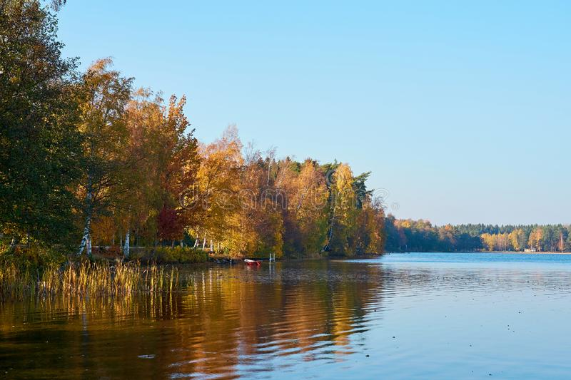Autumn on the lake. Colorful trees are reflecting in water. royalty free stock photos