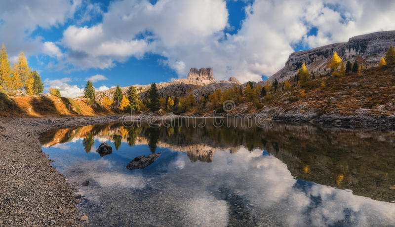 Autumn on lake Limides and views of mount Averau stock photography