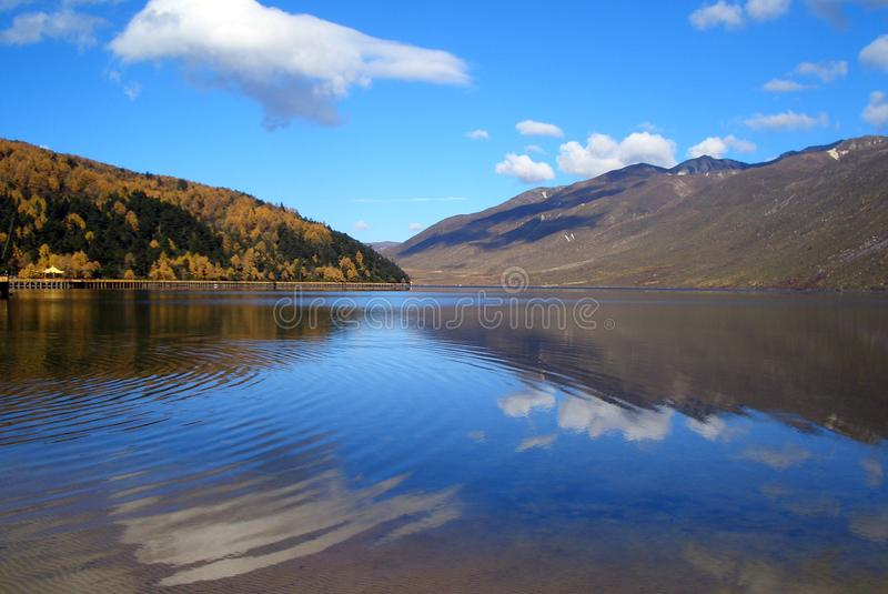 Autumn lake and sky stock photography