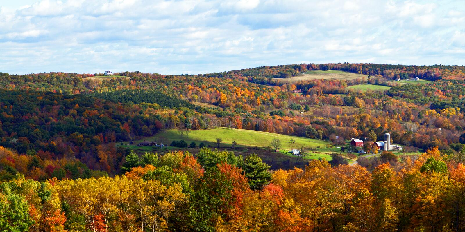 Autumn landscape. Sunny Autumn panorama of forested hills and farm fields in the Hudson Valley of New York stock photo