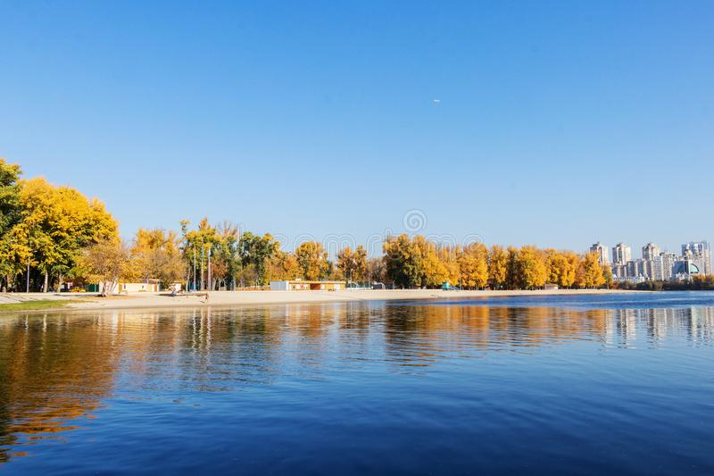 Autumn landscape Beach City on the Dnieper River in Kiev. Autumn landscape city beach for rest Hydropark on the river of the Dnieper in Kiev royalty free stock photography
