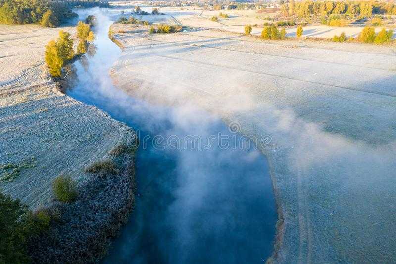 Autumn landscape with fog and river royalty free stock images