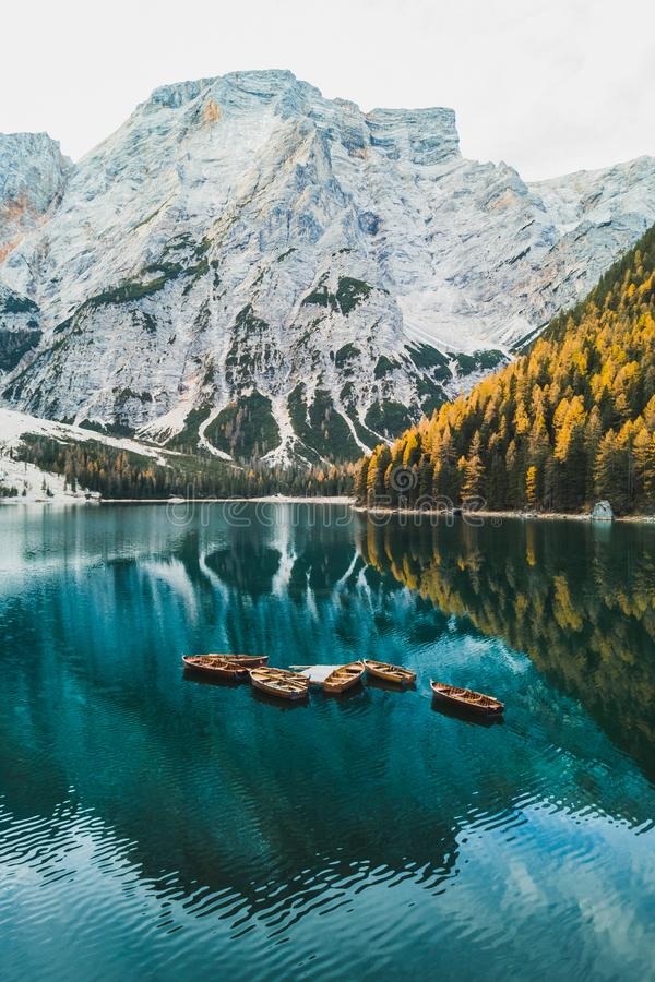 Autumn landscape of Lago di Braies Lake in Italia. N Dolomites mountains in northern Italy. Drone aerial photo with Wooden boats and beautiful reflection in calm royalty free stock photo