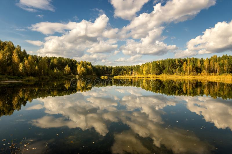 Autumn landscape on the lake with birch forest on the shore, Russia, Ural,. September stock photography