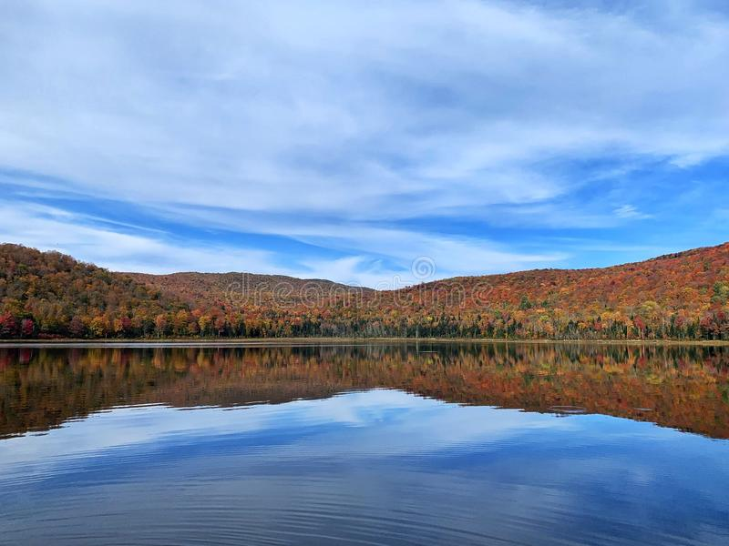 Autumn landscape with lake and blue sky stock photo