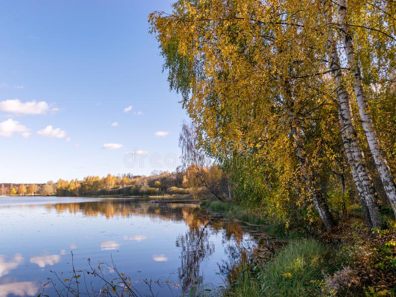 Autumn landscape by the lake, golden autumn, colorful trees and reflections stock image