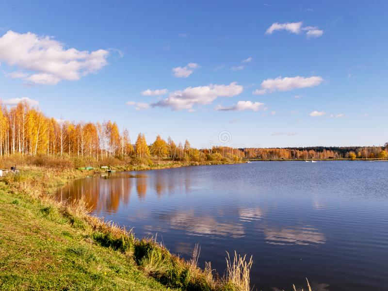 Autumn landscape by the lake, golden autumn, colorful trees and reflections royalty free stock photography