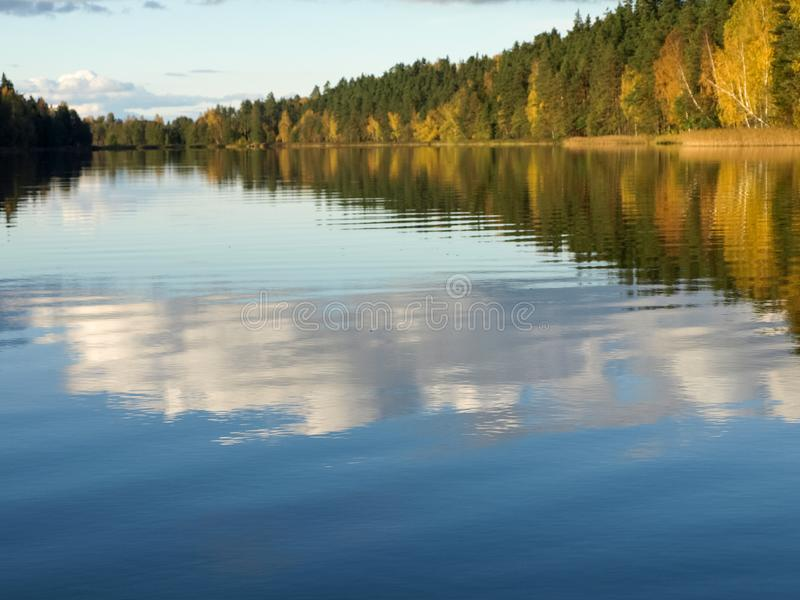 Autumn landscape with lake and gorgeous trees, beautiful reflections in calm water stock photos