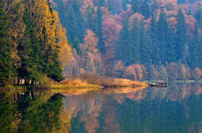 Autumn landscape in the mountains. Wit water reflection royalty free stock photography