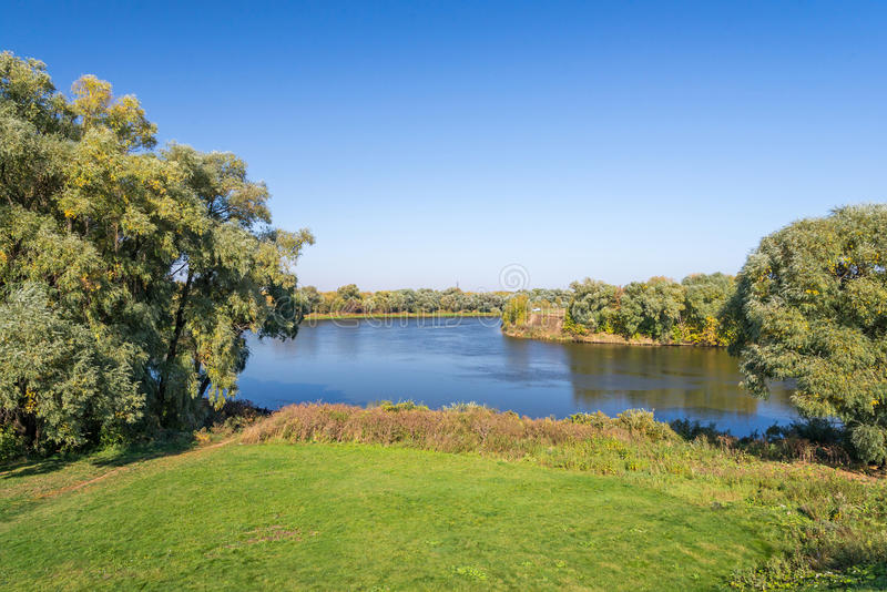 Autumn landscape of river and trees in a sunny day stock photo