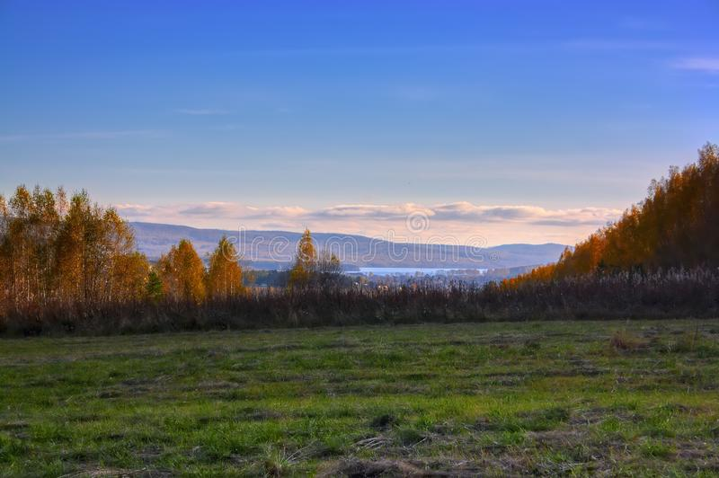 Autumn landscape sloping meadow on a background of forest and mountains. Ural Russia royalty free stock photos
