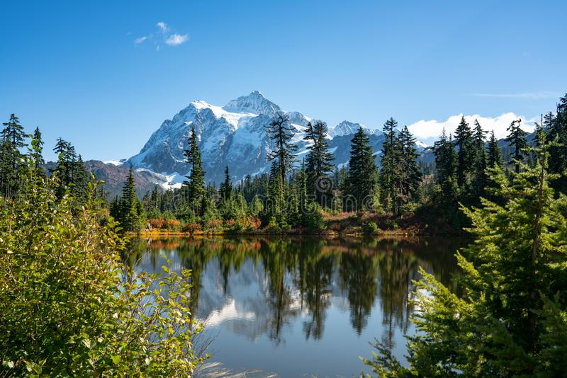 Autumn landscape of snow mountain. And lake in Mt. Baker Hwy, Deming, USA stock photo