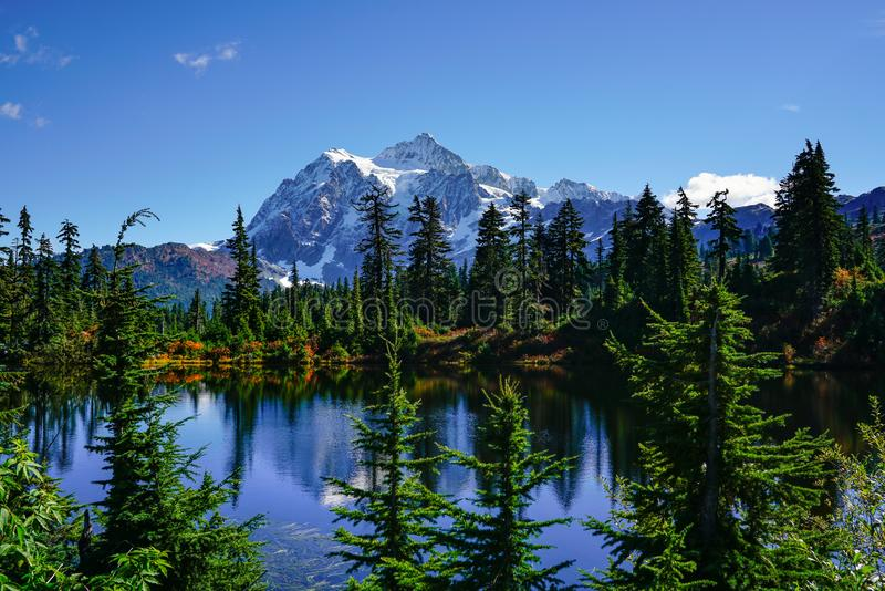 Autumn landscape of snow mountain. And lake in Mt. Baker Hwy, Deming, USA stock photos