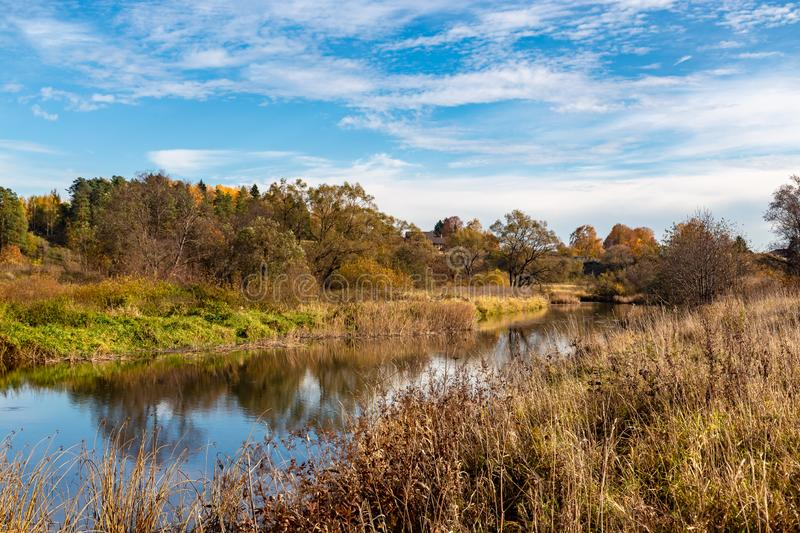 Autumn landscape. View of the river and autumn forest royalty free stock photography