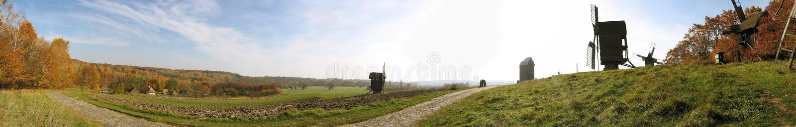 Autumn landscape with windmill royalty free stock images