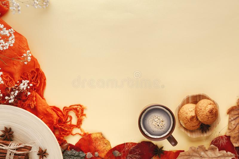 Autumn leaves, cookies and cup of hot coffee stock photography