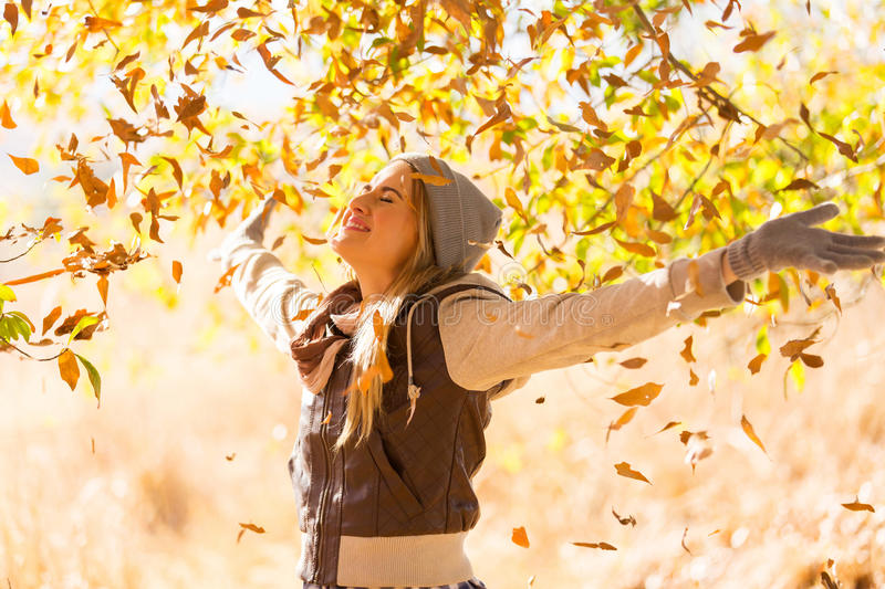 Autumn leaves falling. On happy young woman in forest stock images