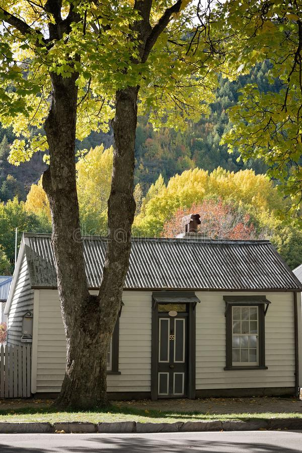 Historic Cottage Against A Backdrop Of Autumn Leaves royalty free stock photos