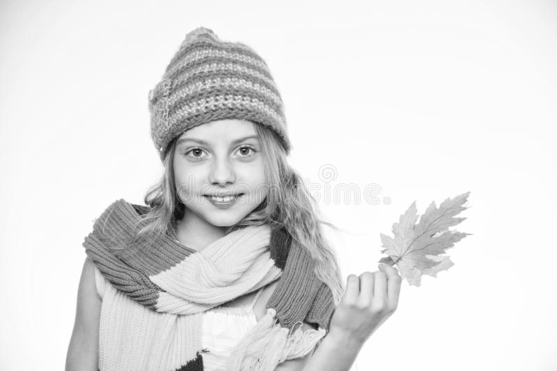 Autumn leisure idea. Girl with maple leaf think about leisure. Autumn to do list. Autumn bucket list for children. Girl. Cute face wear knitted autumn hat and stock photos