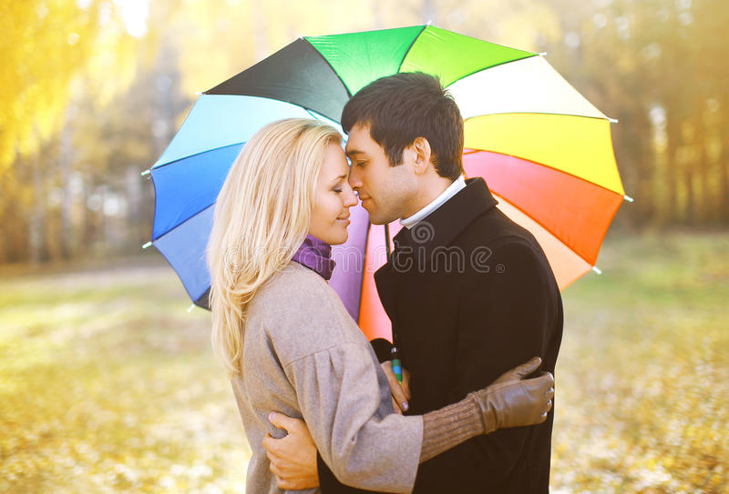 Autumn, love, relationships and people concept - sensual couple stock image