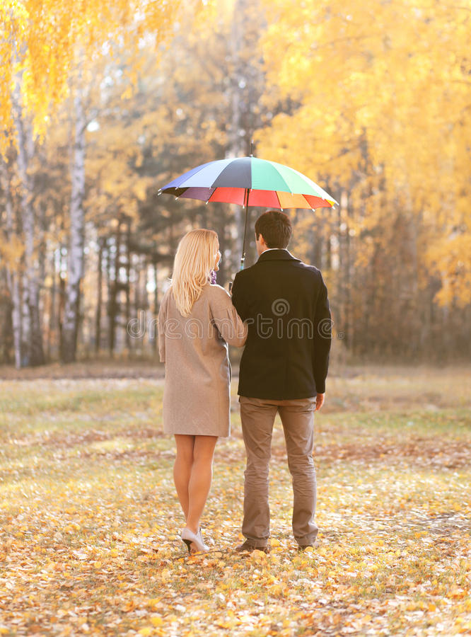 Autumn, love, relationships and people concept - young couple royalty free stock photography