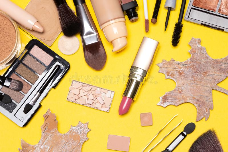 Autumn make up flatlay with maple leaves made of bark stock images