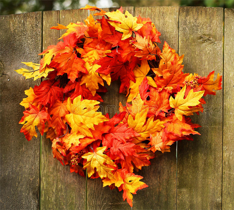 Autumn Maple Wreath. On Wooden Fence royalty free stock images