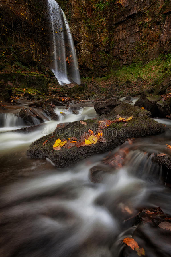 Autumn at Melincourt. Beautiful Autumn leaves at Melincourt waterfalls in Resolven, near Neath, South Wales royalty free stock images