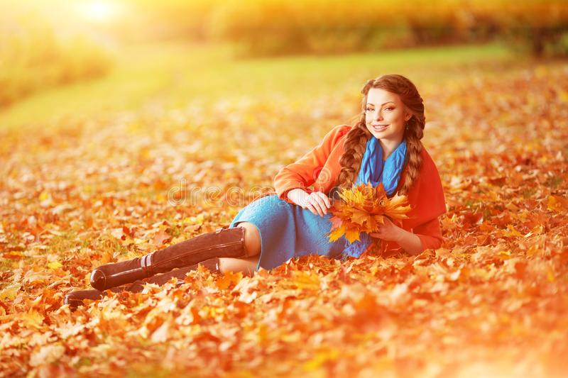 Autumn model, bright make up. woman on background fall landscape. Leaves of trees. Girl Model on autumn season. Fashion people stock photo