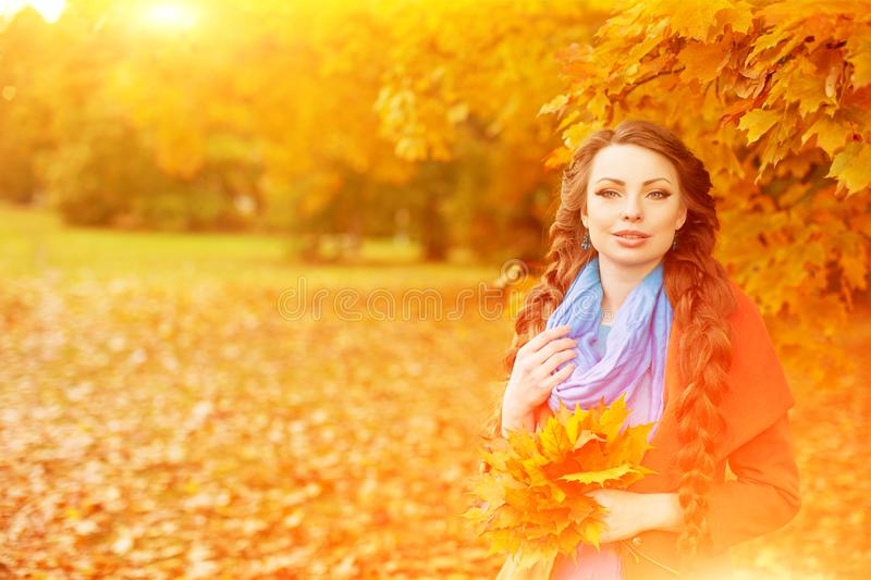 Autumn model, bright make up. woman on background fall landscape. Leaves of trees. Girl Model on autumn season. Fashion people stock images