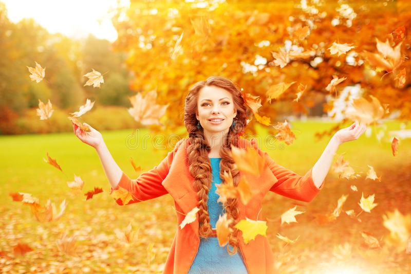 Autumn model, bright make up. woman on background fall landscape. Leaves of trees. Girl Model on autumn season. Fashion people. Girl throws autumn leaves stock images