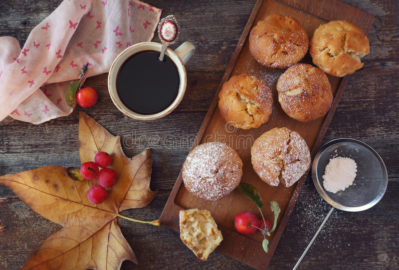 Autumn mood: apple muffins and coffee stock image