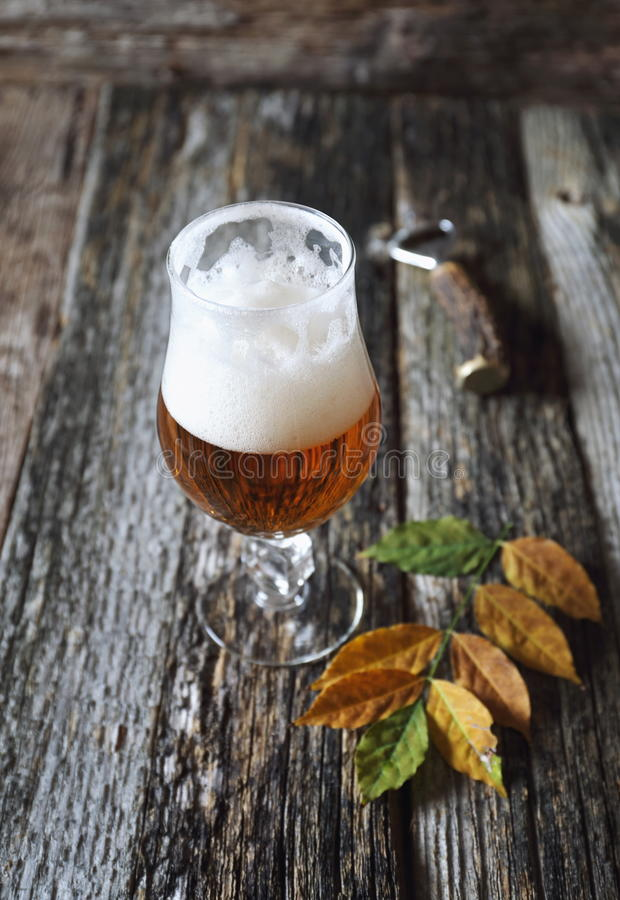 Autumn mood: beer and yellow leaves royalty free stock images