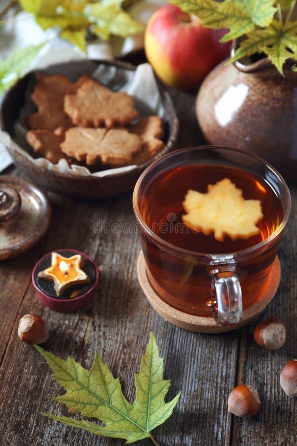 Autumn mood: cinnamon cookies, tea and red apple royalty free stock photo
