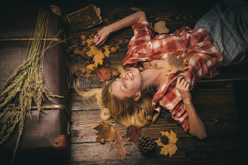Autumn mood and the weather are warm and sunny and rain is possible. Beautiful girl with background board for Copyspace stock photography
