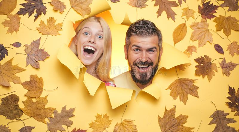 Autumn mood and weather are warm and sunny and rain is possible. Happy couple, bearded man and blond woman in yellow royalty free stock images