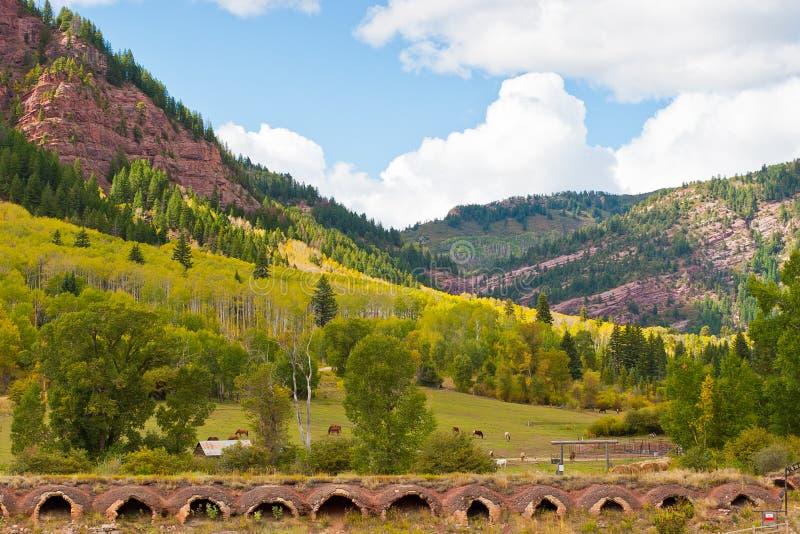 Autumn mountain landscape in Colorado, USA. Autumn mountain landscape with old coal ovens on foreground in Colorado, USA royalty free stock photo