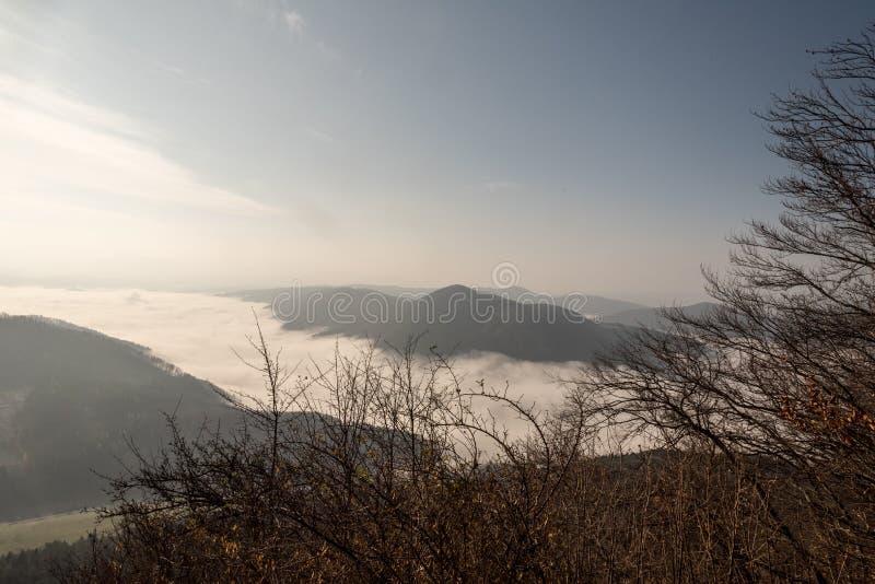 Autumn mountain landscape with mist on valleys, mountain ranges and blue sky in Slovakia. Autumn mountain landscape with mist on Vah river valley, mountain royalty free stock photos