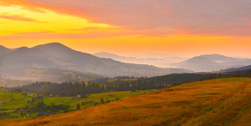 Autumn mountains at sunrise with morning mist. royalty free stock photos