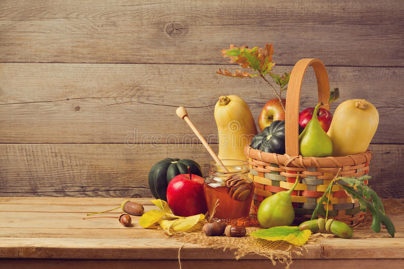 Autumn nature concept. Fall fruits and pumpkin on wooden table. Thanksgiving dinner. Set