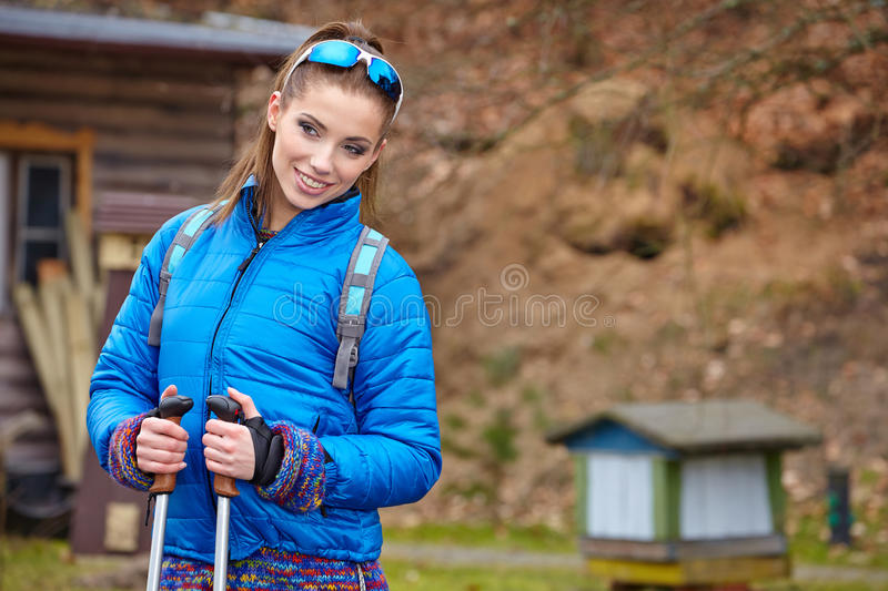 Autumn Nordic walking - active woman. Exercising outdoor royalty free stock image