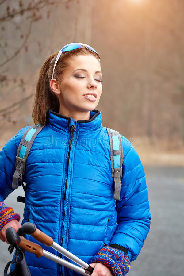 Autumn Nordic walking - active woman exercising outdoor.  royalty free stock images