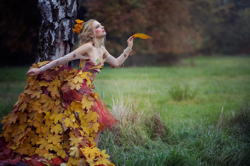 Autumn Nymph. Beautiful Autumn Nymph in the fairy forest. Fashion photo
